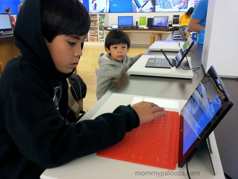My oldest son trying out the new Surface tablets. #GoMicrosoft