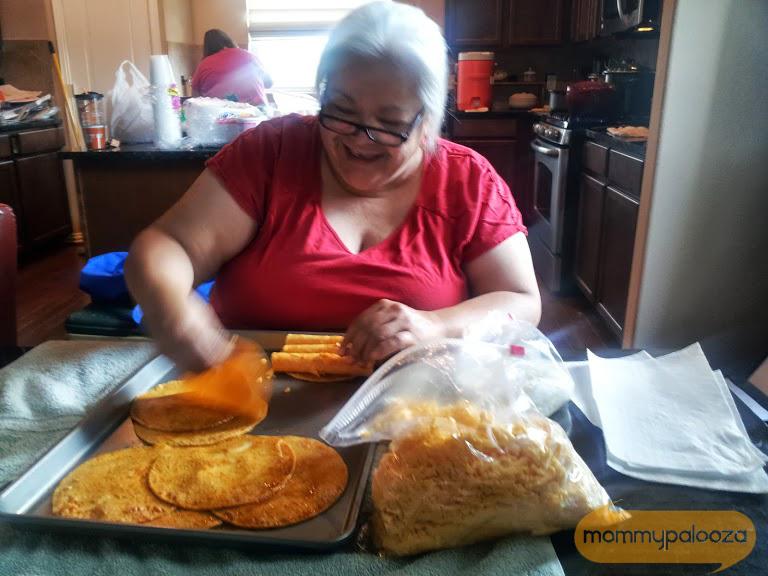 Aunt Mary rolling enchiladas!