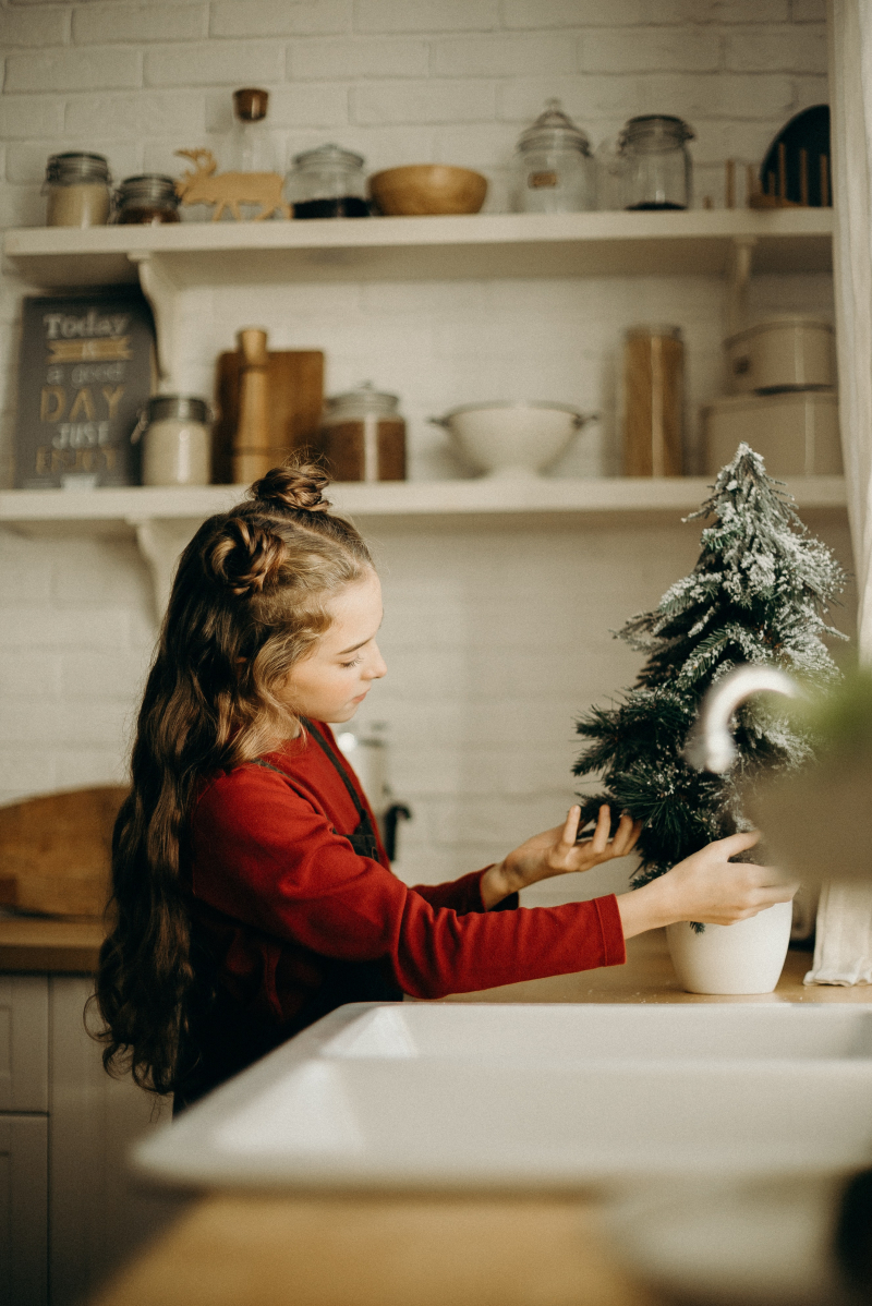 Little-girl-checking-on-a-christmas-tree-3154302